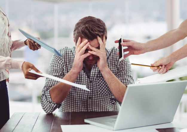 An employee experiencing stress related to work due to multiple demands